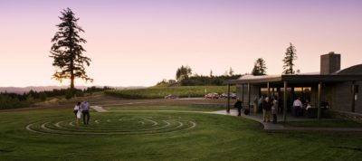 Guests enjoy estate-grown wine as the sun sets above the labyrinth at Fairsing Vineyard.