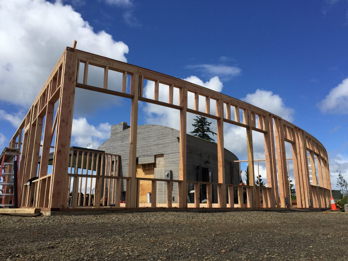 Framing the curvature of the north exterior wall of Fairsing Vineyard