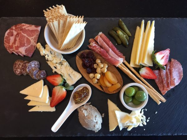 The Mt. Jefferson tasting experience includes a diverse range of select cheeses, charcuterie and light bites - a culinary homage to the peak itself.