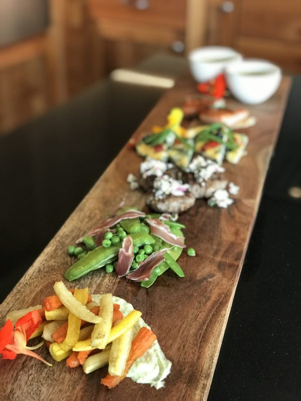 The Mt. St. Helens tasting experience at Fairsing Vineyard showcases a variety of seasonal and regional light bites with savory offerings from our kitchen.