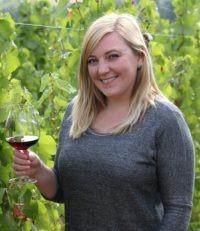 Fairsing Vineyard Hospitality Lead Margaret Kurtz with wine among the vines