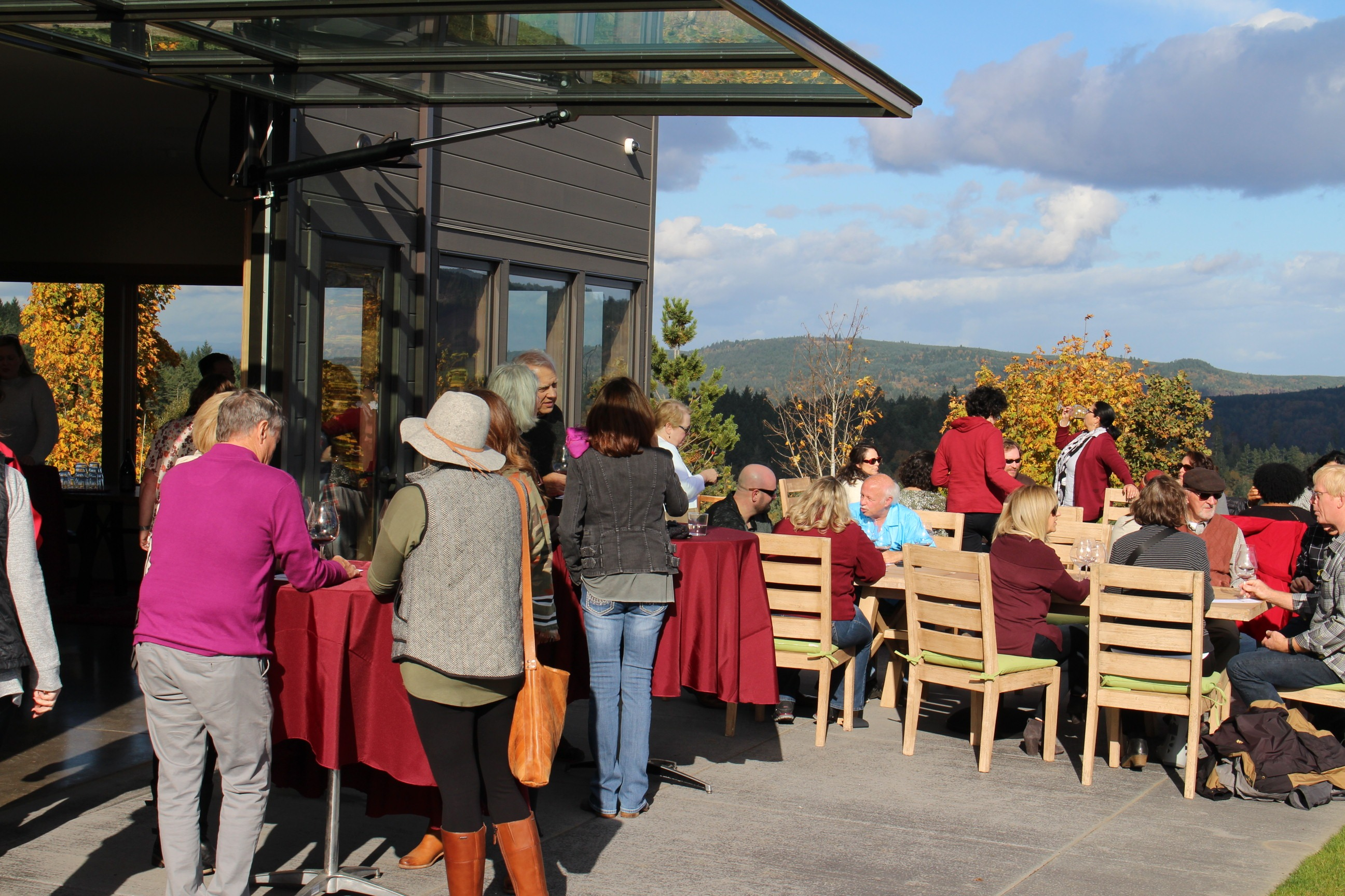 Fairsing Vineyard Wine Club members conversing on the patio during the 2018 fall open house