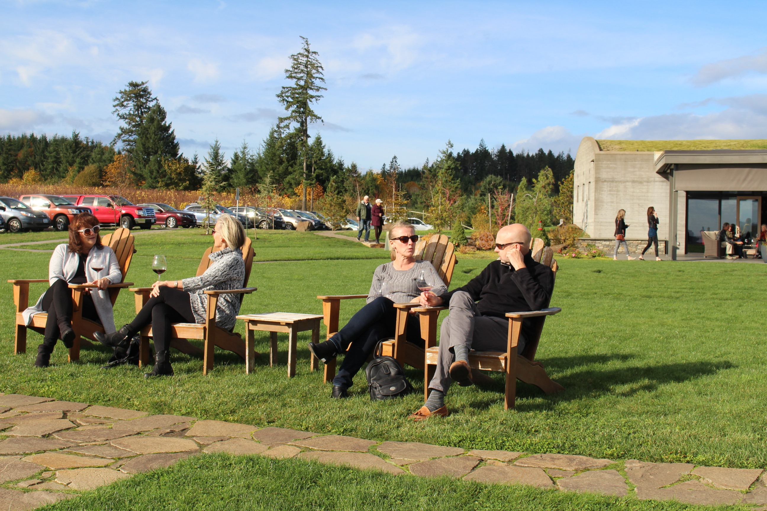 Fairsing Vineyard Wine Club members soaking up the sunshine and panoramic views during the fall open house