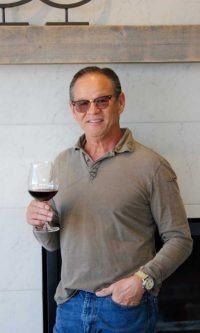 Bob Negele with Fairsing Vineyard enjoying a Pinot noir in the event center