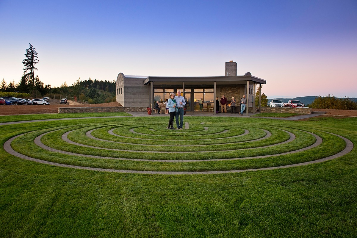Fairsing Vineyard owners amid the labyrinth surrounded by Oregon's Willamette Valley