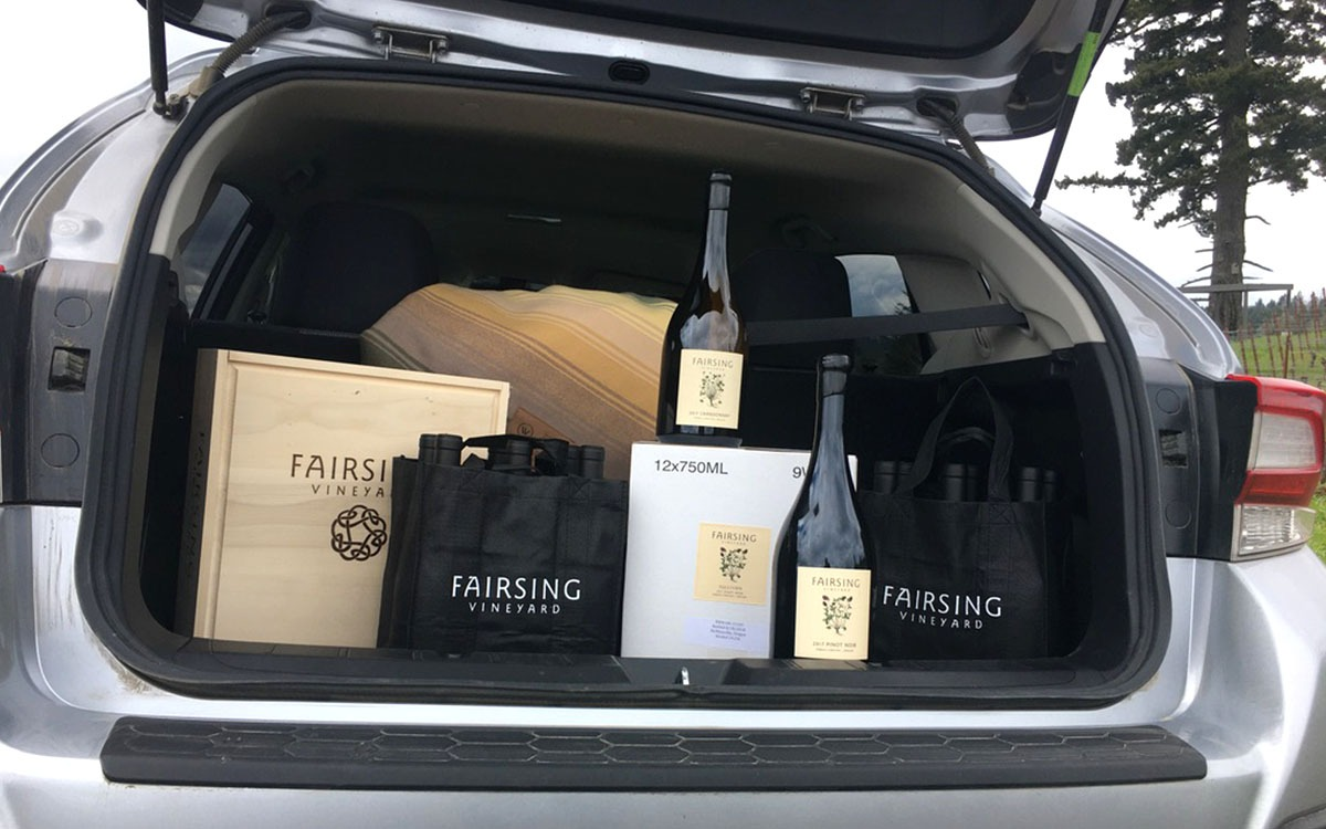 A car trunk loaded with Fairsing wines parked at the vineyard located in Oregon's Willamette Valley