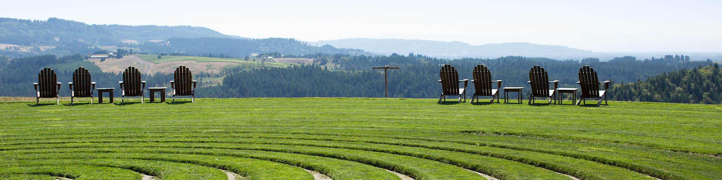 Chairs outside the Labyrinth at Fairsing Vineyard sit idle beneath the summer sun in Oregon's Willamette Valley