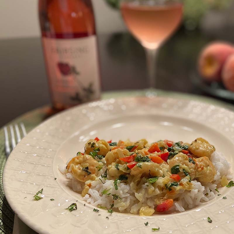 The Fairsing Vineyard Thai Yellow Curry with Spinach and Red Pepper complements the 2019 Rosé of Pinot noir